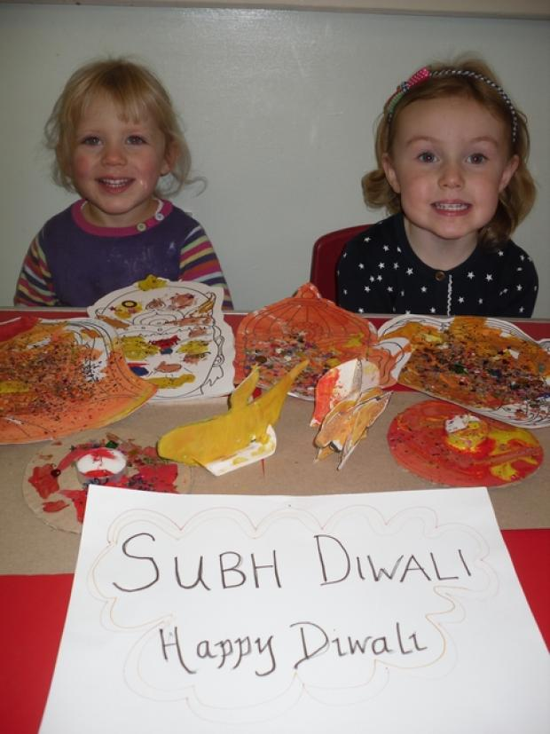 Diwali celebrations: Stay and Play Group youngsters Phoebe McManus, aged two, and Lily Peat, aged three, took part in Diwali-themed craft activities. Ref:s