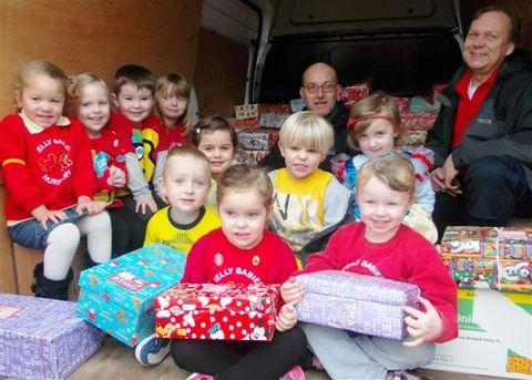 Samaritans Purse representatives Mike Lockett and Brian Palmer with youngsters from Jellybabies Nursery