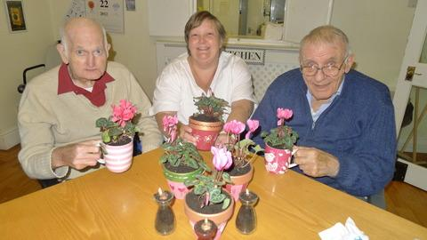 Sue Macfarlane, activities co-ordinator at Wayside Care Home, with plant pots produced by residents, including Michael Trow and Bryan Turner