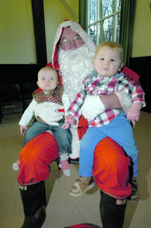 Father Christmas visited the children of Lickey Baby and Toddler Group, including youngsters Freddie Williams, 11 months, and Cade Thomas, 16 months.  Buy this photo BMM521202a