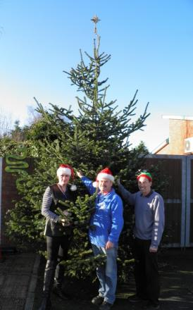 Tree-mendous gesture: Chris Schofield, centre, with Acorns' Mandie Fitzgerald and Tony Williams.