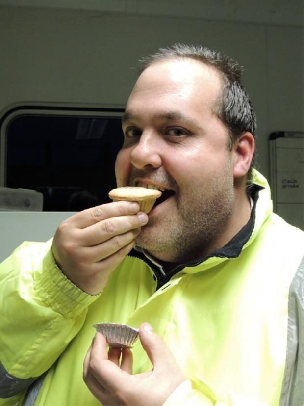Festive treat: Alan Jones enjoys a mince pie.