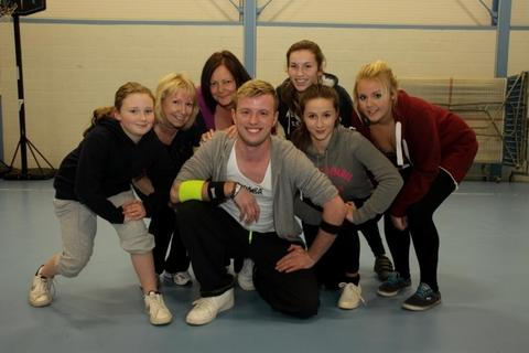 Instructor Stephen Corbett with the fund-raisers who took part in a Zumba class raising money for a campaign helping a North Bromsgrove High School pupil. Ref:s