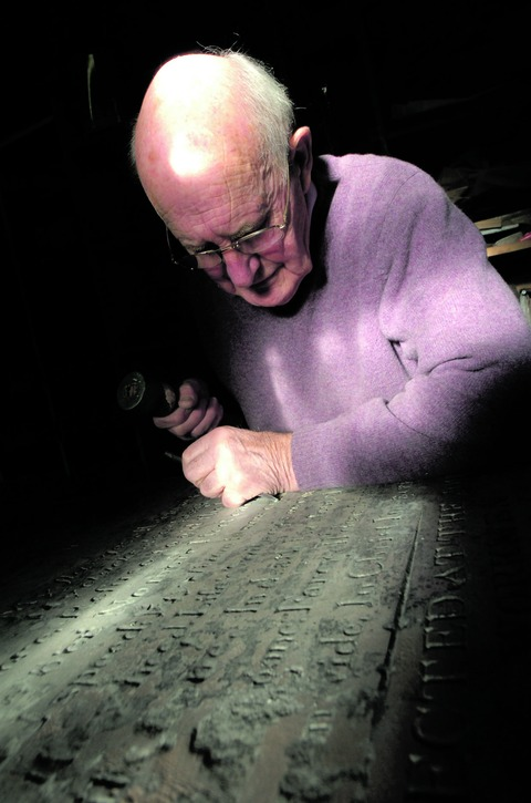 Painstaking work: Bromsgrove craftsman Mike Ford is restoring the historic railwaymen gravestones in his New Road workshop. Buy this photo BMM511202a