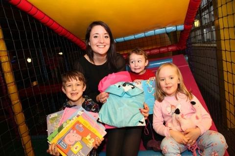 Carer campaign: Amy Garrett from the Swan Inn, with Luke and Alex Bailey, and Clara Phillips, at the launch of the Pyjama Project campaign supporting child carers. Ref:s