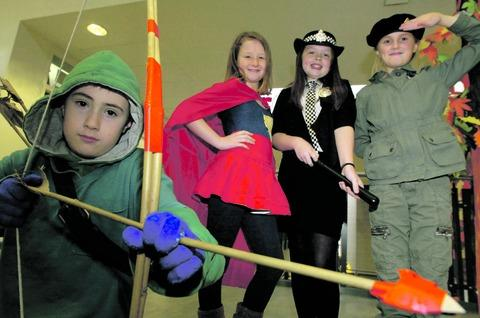 Hero worship: Parkside Middle School pupils Ryan Price, Beth Waring, Nicole Wigley and Phoebe Fletcher during the hero day at Bromsgrove school.  Buy this photo BMM031302a
