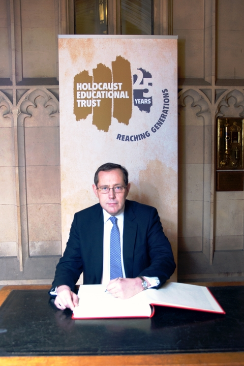 'Never forget': Peter Luff signing the Holocaust Book of Commitment in the Commons.