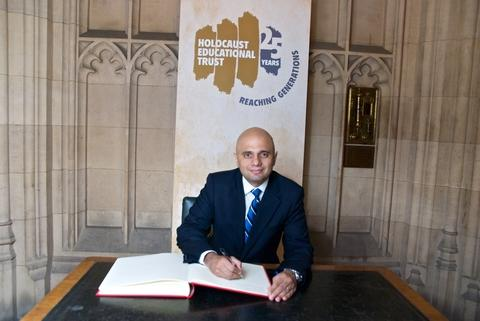 Pledging commitment: Bromsgrove MP Sajid Javid signs the Holocaust Educational Trust's book of commitment in the House of Commons. Ref:s
