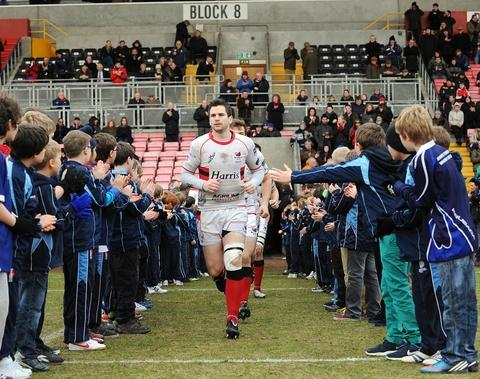 Big stage: Boars skipperJon Critchlow leads his team out at the 25,000 seater stadium. Picture: Pete Jepson.