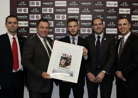 Team players: Aston Villa's Andreas Weimann, centre, presents OGL employees, from left, Paul Stead, Kevin Crowe, Lyndon Bendall and Frazer Doe with a memento from the OGL-sponsored Barclays Premier League match.