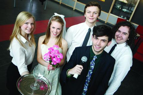 Wedding rehearsal: South Bromsgrove High School pupils Erica Halley, 16, Emily Wightman, 16, Will Jefford, 17, Cam Kouhi, 18, and Ben Salmon, 17, who are performing in The Wedding Singer this month.  Buy this photo BCR061301_a
