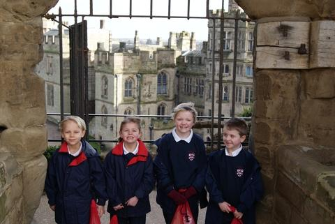 Medieval quest: Bromsgrove Pre-Preparatory School pupils Archie Stone, six, Megan Wilson, six, Libby Rolph, seven, and seven-year-old Thomas Griffiths enjoyed a visit to Warwick Castle. Ref:s