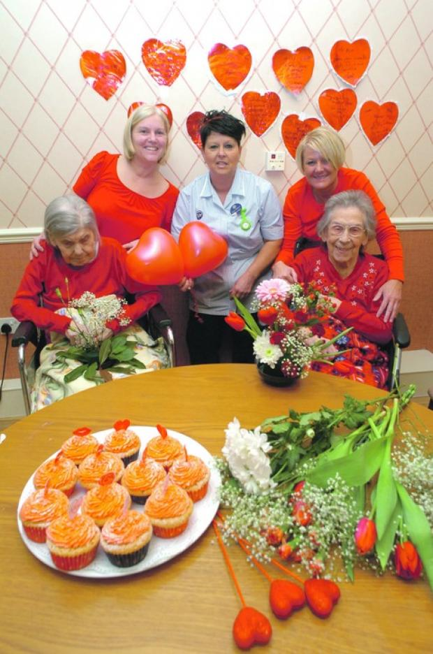 Love is in the air: St John's Court Nursing Home staff Heather Mitchell, Karen Hepherd, and Michelle Thomas, with residents Edith Merrick and Dorothy Cull, who took in a Valentines Day fund-raiser. Buy this photo BMM071302b