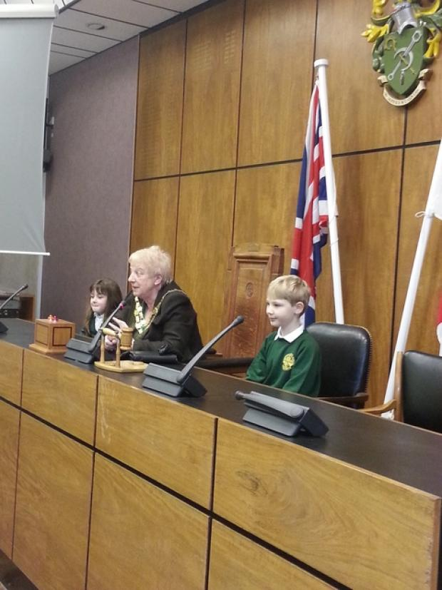 Sophie Grant and James Rose talk about local issues in the council chamber at Bromsgrove District Council, with chairman Councillor June Griffiths.