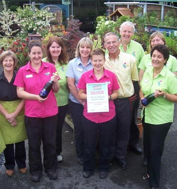 Champagne moment: Staff from Fresh @ Burcot Garden Centre celebrate a silver award in a national competition. Ref:s