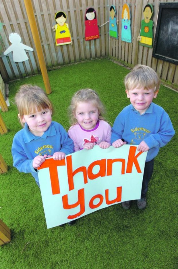 Big thank you: Sidemoor Pre-School youngsters Alfie Hale, four, Kayla Edwards, three and Sophie Allington, three, at the new outdoor classroom.  Buy this photo BMM101306b