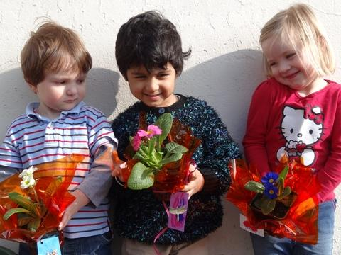 For mum: Abacus Nursery youngsters Lucas Whitehead, Arjan Rayet and Esme Patterson, all aged three, with their special Mother's Day primulas. Ref:s
