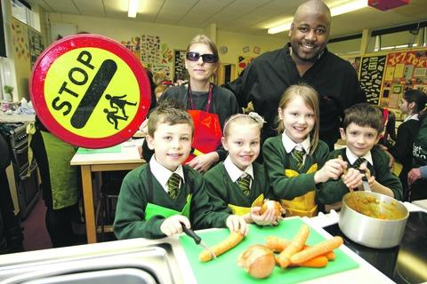Lollie Francis, the school's lollipop lady, Lorenzo Richards, from the Wildmoor Oak, with pupils Harvey Thomas, 10, Lucy Hubbard, eight, Sally Pugh, three, and David Gwynn, nine, who all took part in a cooking challenge.