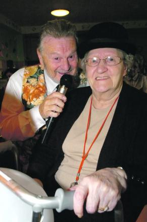 Turned green: David Sanders entertains the residents of Breme Care Home including Gwen Woolley, at its St Patrick's Day celebrations. Buy photo BMM121301a