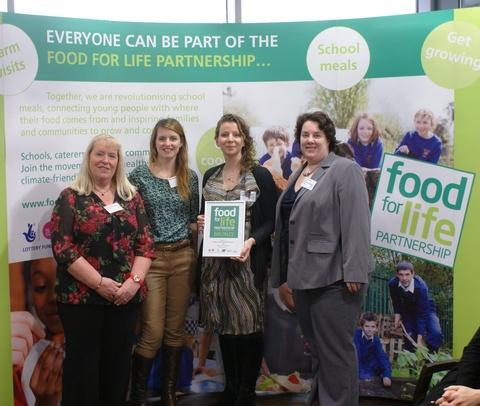 Award winners: Aston Fields Middle School staff receive a bronze Food for Life Partnership award from television presenter Katie Rushworth. Ref:s