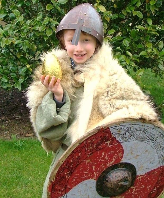 Open air museum: Peter Caffrey, six, prepares for a Viking invasion at Avoncroft Museum this Easter. Ref:s