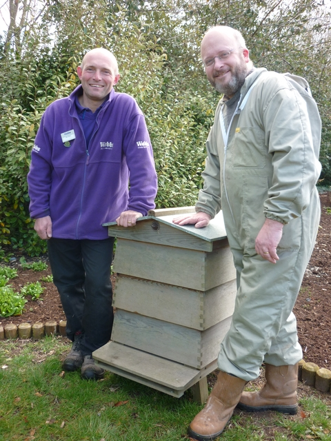 Mike Rutter of Webbs with beekeeper Chris Broad.