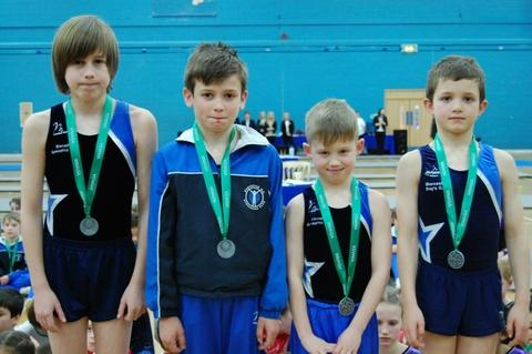 High flyers: Benjy Wiggins, Theo Thomas, Tody Grant and Joe Thomas with their medals.