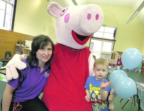 Play N Discover youngsters including Harry Sealey, three, met Peppa Pig at a recent open day. Pictured with pre-school manager Sue Overton.