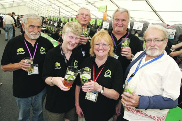HAIL TO THE ALE: Dave Morton, Phil Hosier, Simon Vicker, Val Hosier, Lynn Fitton, and Doug Fitton were among those who enjoyed Bromsgrove's annual beer festival.