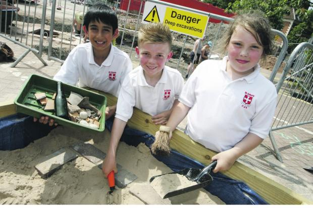 HISTORICAL DIG: St John's Middle School pupils Inaam Arif, 10, Harvey Langston, nine, and Tiffany Burchell, 10, visit the dig site. Buy this