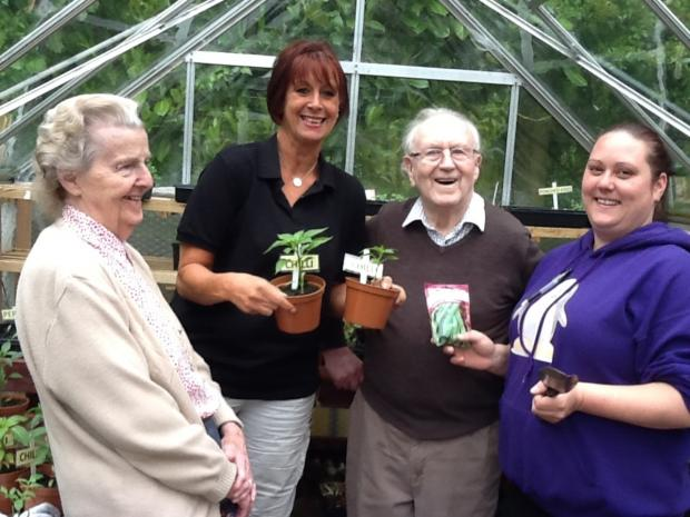 Pat Davies, Liz Fraser from Littleheath, Bernard Hathaway and The Lawns team leader Rebecca Guy. SP