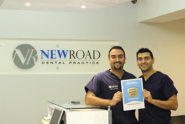 AWARD: Principal dentists and brothers Dr Ravi and Dr Pritesh Solanki celebrate New Road Dental Practice receiving a customer service award. SP
