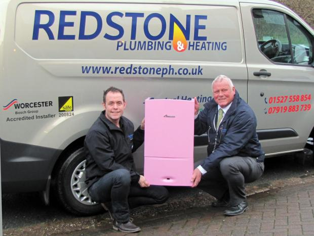Paul Bennett with Dave Stimmson, area rep for Worcester Bosch and the pink boiler. SP