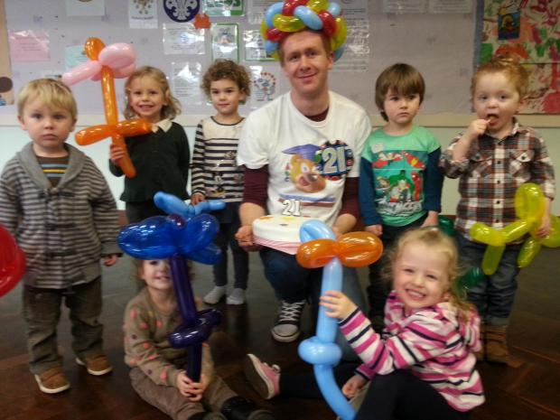 BIRTHDAY CELEBRATIONS: Volunteer Robert Walker celebrated his 21st birthday with youngsters from the Plus 2s Playgroup. SP