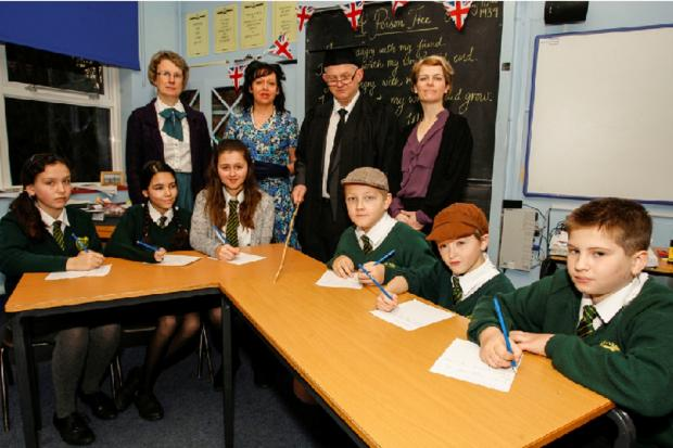 BACK IN TIME: Staff and pupils participated in a 1939 day to celebrate Catshill Middle School's 75th anniversary.   Buy this photo RCR031401_01