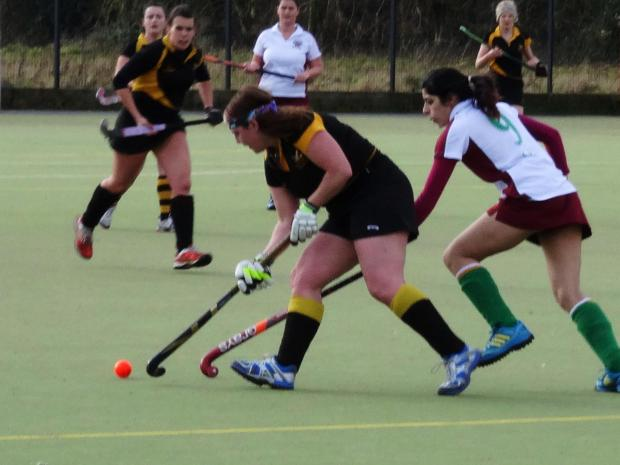 Friendly success: Claire Darby takes on a Barford player for Droitwich Ladies.