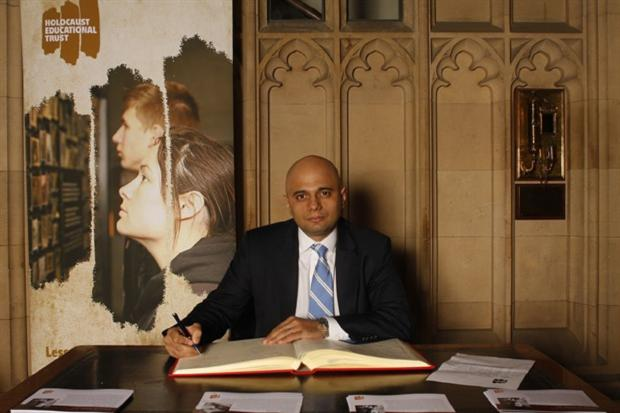 MEMORIAL DAY: Bromsgrove MP Sajid Javid signed a book of commitment to support this year's Holocaust Memorial Day . SP