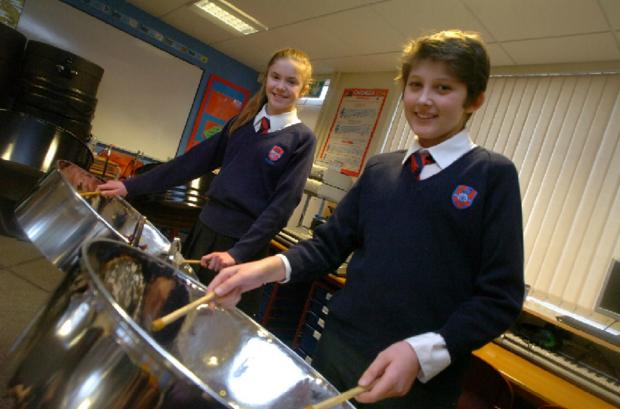 Pupils at  Aston Fields Middle School took part in All Different, All Equal day. Pictured are Amelia Duncan 12 and Taylor Whitt 11, on the steel drums.   Buy this photo BMM081401a
