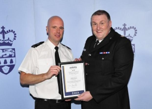 COMMENDATIONS: PC Barney Kelso receives his commendation from Superintendent Kevin Purcell. SP