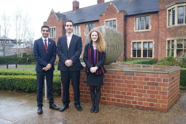 Students Aoife Swords and Rayan Meeran with John Turner of the British Red Cross