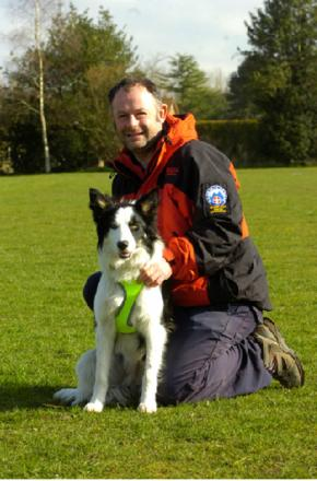 Matthew Massey, who is taking part in a charity walk, with Dyno the search and rescue dog.   Buy this photo BMM111404a
