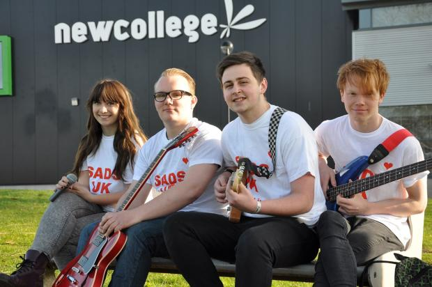 Kate Rose, Sam Caseley, Ben Henderson and David Taylor prepare for the concert