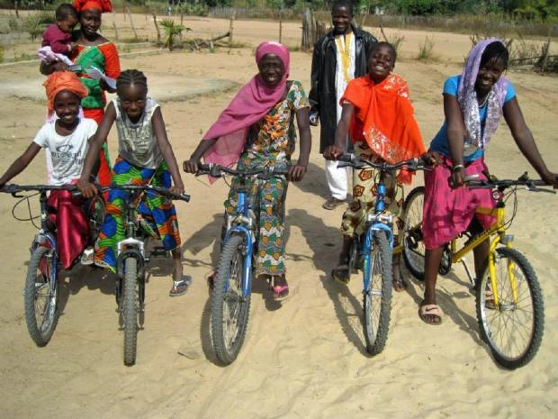 CHANGING LIVES: People's lives in Africa have been transformed after receiving a bike through Halfords and Re-Cycle's initiative. SP