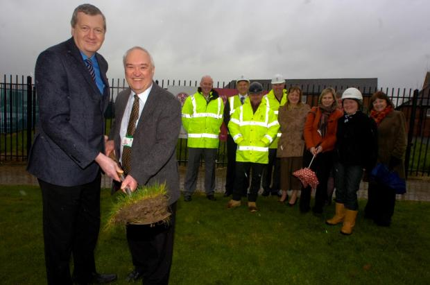 Bromsgrove Advertiser: Worcestershire County councillor Anthony Blagg and leader of Bromsgrove District Council Roger Hollingworth at the former Parkside site