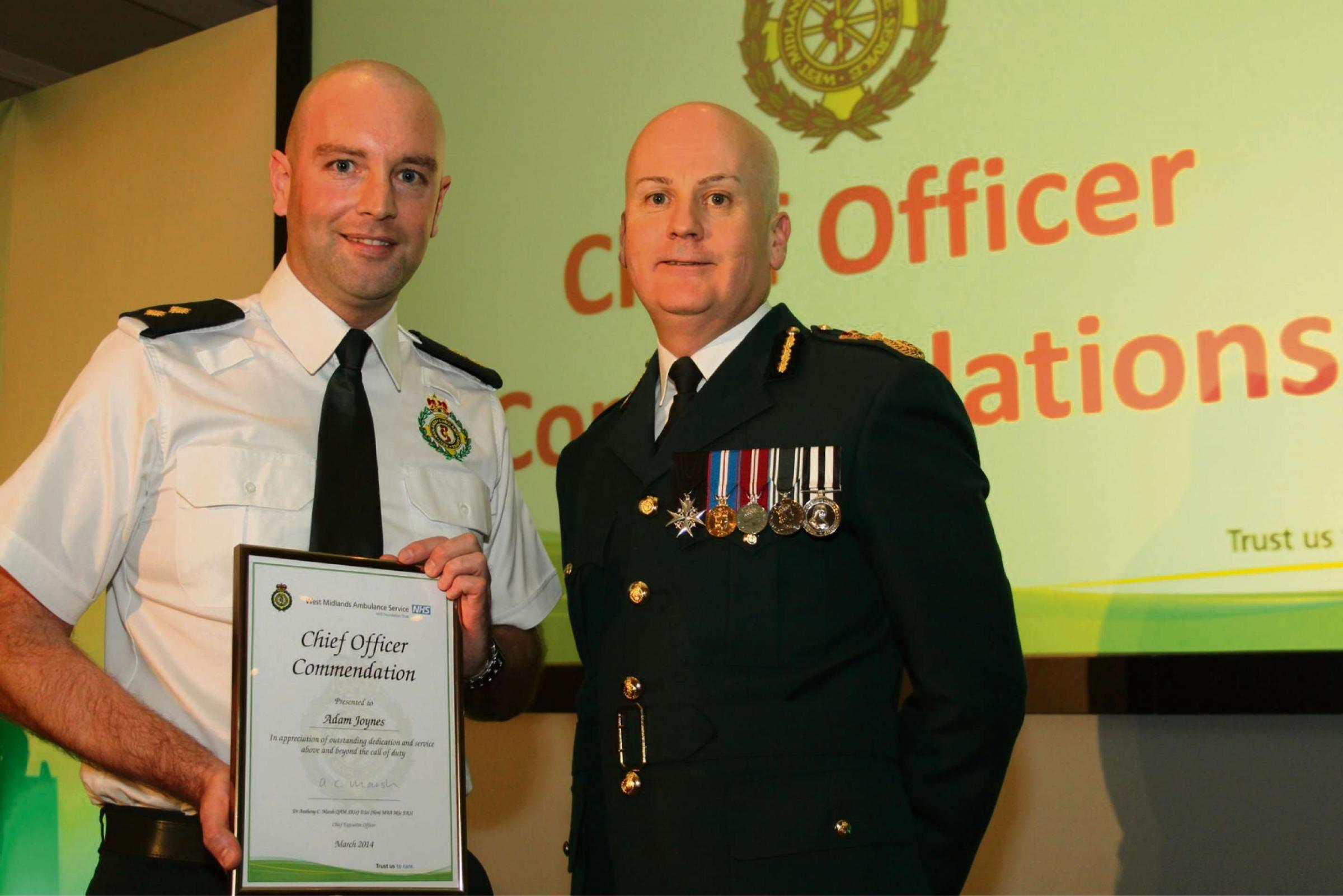 Chief executive of the regional West Midlands Ambulance Service Anthony Marsh with award winner Adam Joynes (photo courtesy  of West Midlands Ambulance Service)