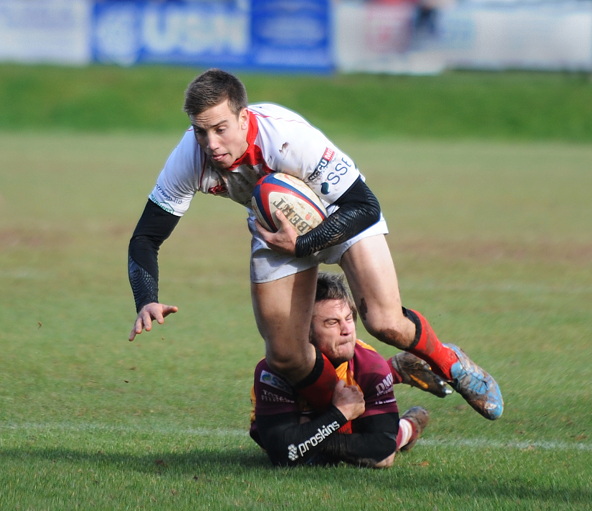 Effective display: Elliott Davies is tackled by a Sedgley Park player.  Picture