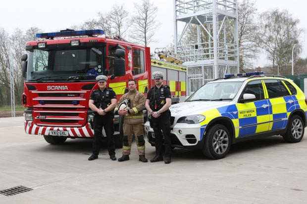 Bromsgrove Advertiser: EMERGENCY STATION: PC John Mounter and PC Owen Atwell, from West Mercia Police's Operational Patrol Unit, with Hereford and Worcester Fire and Rescue Service Watch Commander Darren Packwood at the new combined emergency station. SP