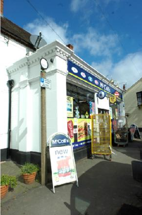 RAID: A gang of masked men threatened staff during a robbery at McColls newsagents.