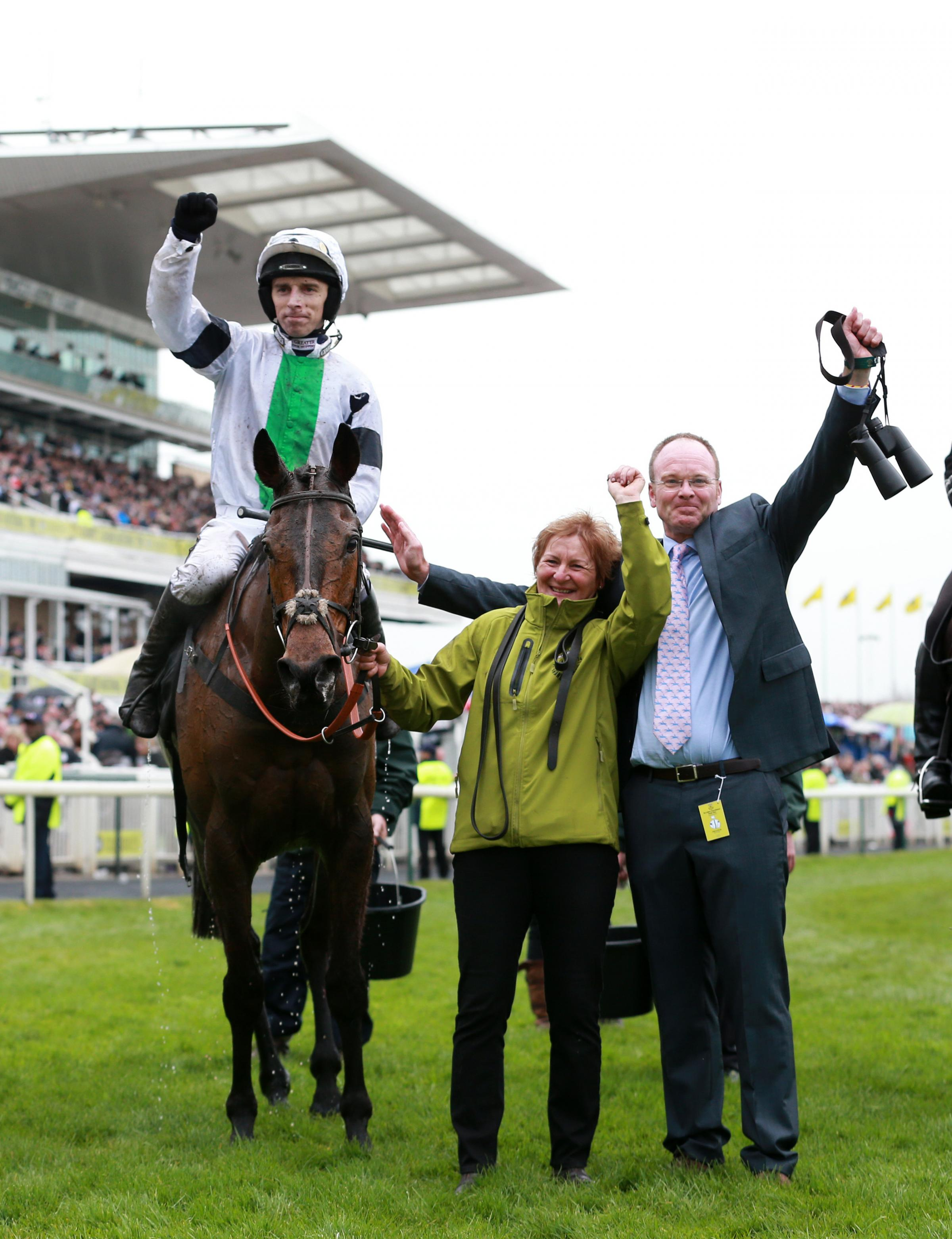 Leighton Aspell celebrates on Pineau De Re with trainer Dr Richard Newland (right) after winning The Crabbie's Grand National Steeple Chase during Grand National Day of the Crabbie's Grand National 2014 Festival at Aintree Racecourse.