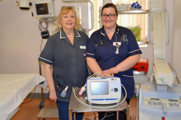 Bromsgrove Advertiser: Cardiac assessment nurses with Worcestershire Acute Hospitals NHS Trust Sue Amos and Sally Baker with a cardioversion machine